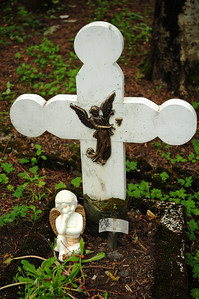 Amid the basalt headstones, we found this small gravesite of a child.