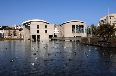 In the lake's northwest corner is the modern Ráðhús, Reykjavík's City Hall, built in the 1980s.