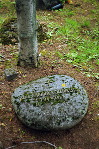 In some grave plots plain, unpolished volcanic boulders were used as headstones.