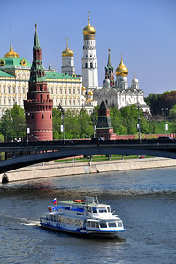 At ground level, the walls hide many of the Kremlin's structures.  But from certain vantage points around the city -- for example, a bridge near the Christ the Savior Cathedral -- the towers and domes inside the ancient fortress rise well above the outer walls.