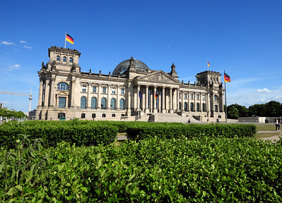 """Some 200 yards north of the Brandenburg Gate is the Reichstag, where Germany's parliament meets.  It was opened in 1894.  Kaiser Wilhelm II, in power at the time, saw it as the """"height of tastelessness"""" and """"a place for chatting"""" –  a judgment probably colored by his opinion of the parliament as an institution of the """"imperial monkey house"""" as he once called it."""