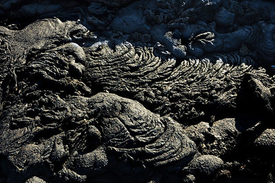 """This is """"pahoehoe"""" lava from a volcanic eruption just a few years ago.  The name means """"ropy,"""" reflecting the twisted, rope-like patterns formed when it cools."""