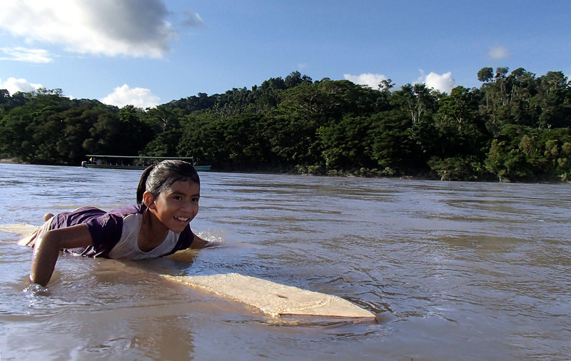 As we made our way down the Rio Napo, our floating entourage was joined by a little local girl...drifting by on a slab of balsa wood.