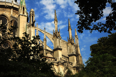 Notre Dame was among the first buildings in the world to use the flying buttress. The building was not originally designed to include these arched supports, but when the walls grew higher, stress fractures began to occur. To counter the outward pressures, the cathedral's architects added supports around the outside walls.