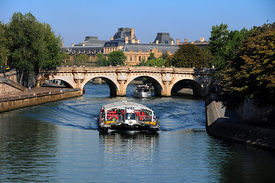 ...the city on the Seine.  The river Seine flows through the heart of Paris. It was no accident that the city evolved around this gigantic avenue for commerce and transportation.