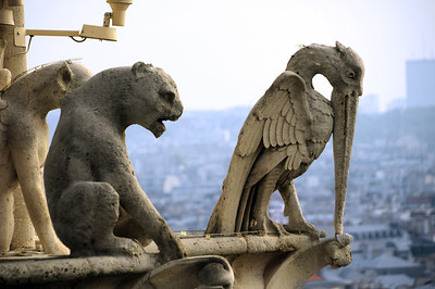 "Actually, these figures are more correctly referred to as ""grotesques.""  Gargoyles typically have a spout that diverts rainwater away from a structure's masonry walls.  Grotesques are strictly decorative...."