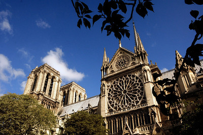During the 200 years it took to build Notre Dame, numerous architects worked on the site, as is evidenced by the differing styles at different heights of the towers. Between 1210 and 1220, the fourth architect oversaw the construction of this portion of the cathedral with the rose window.