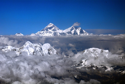 ...remote mountain peaks where snow and sky converge...where icy spires have never seen a human footprint.