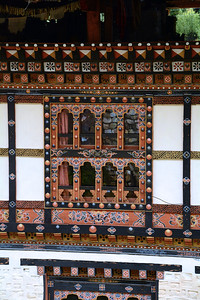 Windows are most often decorated with colorfully painted wooden frames, giving a festive apopearance to even the most modest of buildings.