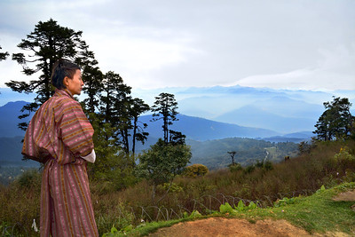 """For centuries, the people of this land heard the wind roar down from from these peaks and through these valleys and believed it to be the thunder of dragons.  They called the land Druk Yul, """"the Land of the Thunder Dragon.""""  We're in a remote, almost mythical country near the rooftop of the world.  We're in Bhutan."""