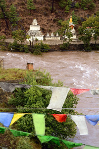 For many traditional Bhutanese the confluence of two rivers - in this case, the Pho Chhu (father river) and the Mo Chhu (mother river) outside Thimphu - is considered an inauspicious place.  To ward off evil spirits in the area, three chortens - religious stupas -- were built.