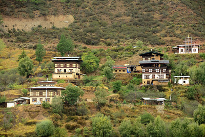 As we made our way through the Bhutan countryside, our eyes were drawn to the unique architecture of the country's homes.   Due to the steep terrain, they are usually built as scattered houses of in clusters, rather than in rows.
