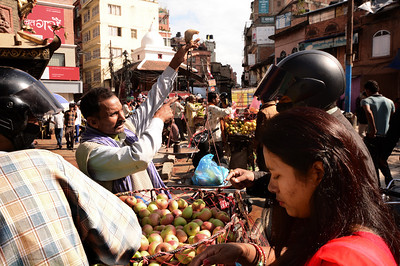 ...making your way around vendors selling fruits...