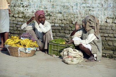 ...with scores of individuals along the sidewalks with small piles of produce to sell.