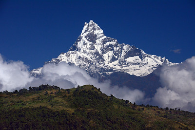 These are the Himalayas – huge, towering spires of rock and ice. This is our world at its most awesome – the crowning apex of nature's grandeur.  This is Nepal.