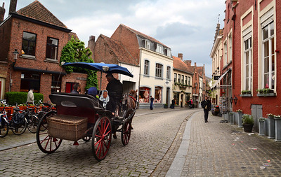 Today, Bruges is like a huge, open-air museum.  All around are meandering canals, cobbled streets, and quiet corners...