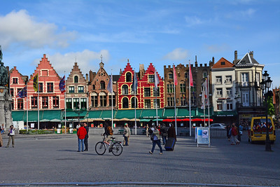 The square is ringed by great old gabled buildings.