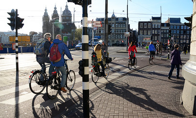 "Stepping out of the Central Station, the first thing you will likely encounter is a beehive of bicyclists. Amsterdam may be the most ""pedal powered"" city in the world."
