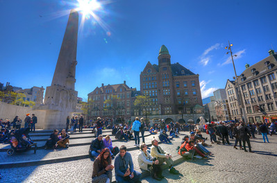 """In the '60s, Dam Square was a mecca for hippies, and the National Monument was one of their favorite venues for love-ins.  In fact, so many camped out around the monument, they became known as the """"Damslapers"""" - Dutch for Dam sleepers.  The city outlawed that in 1970.  Today the common practice is sitting on the monument – rather than sleeping."""