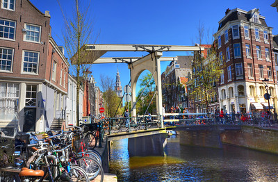 """Once the Amstel river flowed through the center of the city -- through Dam Square, in fact.  In the 13th century, local fisherman built a dam across the river.  The settlement came to be known as """"Aemstelledamme"""" (Amstel dam), or 'dam on the Amstel'.  Eventually the name was shortened to Amsterdam."""