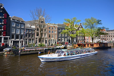 Today it's mostly tourist boats that ply the labyrinth of waterways through downtown Amsterdam...