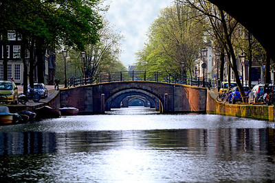 Today Amsterdam's 65 miles of canals have transformed the historic heart of the city into a fan-like  semicircle made up of more than 90 islands, connected by some 1,281 bridges.