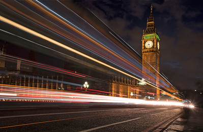 London as a city of lights and action, best typified by passing buses and autos across Westminster Bridge.