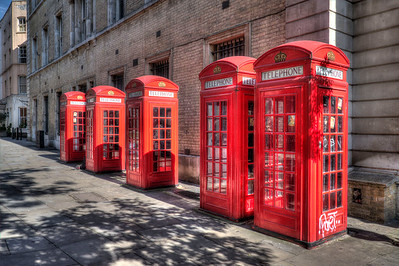 "A revered London icon, the crimson red ""telephone box"" is slowly disappearing.  In 2002 London had 92,000 pay phones; today the number is only 48,000."