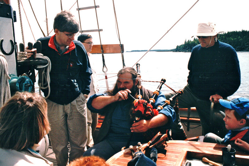 """Maurice Leger, Better Known As Bear is Very Muscially Talented - S/V """"Cory"""" - St. Andrews by the Sea, New Brunswick, Canada  8-25-97<br /> He played the fiddle, mandolin, Irish drum, penny whistle, and bagpipes."""