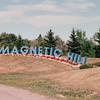 "Magnetic Hill - Moncton, New Brunswick, Canada  8-26-97<br /> Visitors drive ""downhill"" to a spot indicated by a white post and then, with gears in neutral and brakes released, the car moves backward, coasting ""up"" the hill."