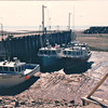 Boats At Low Tide - Alma, New Brunswick, Canada  8-26-97<br /> Such a strange scene.  Must be something to really adjust to dealing with.