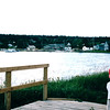 Donna Eating Lunch by Water Near Florence, Cape Breton, Nova Scotia, Canada  8-29-97<br /> Bagels, cheese and juice.