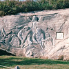 William E. Garthe Memorial Park - Peggy's Cove, Nova Scotia, Canada  8-31-97<br /> Carved on a 100 foot face of a granite outcropping, it depicts fishermen, their wives and children, a guardian angel with wings spread and the legendary Peggy of Peggy's Cove.