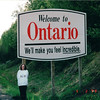 Donna at Highway Sign - Entering Ontario, Canada  6-2-99