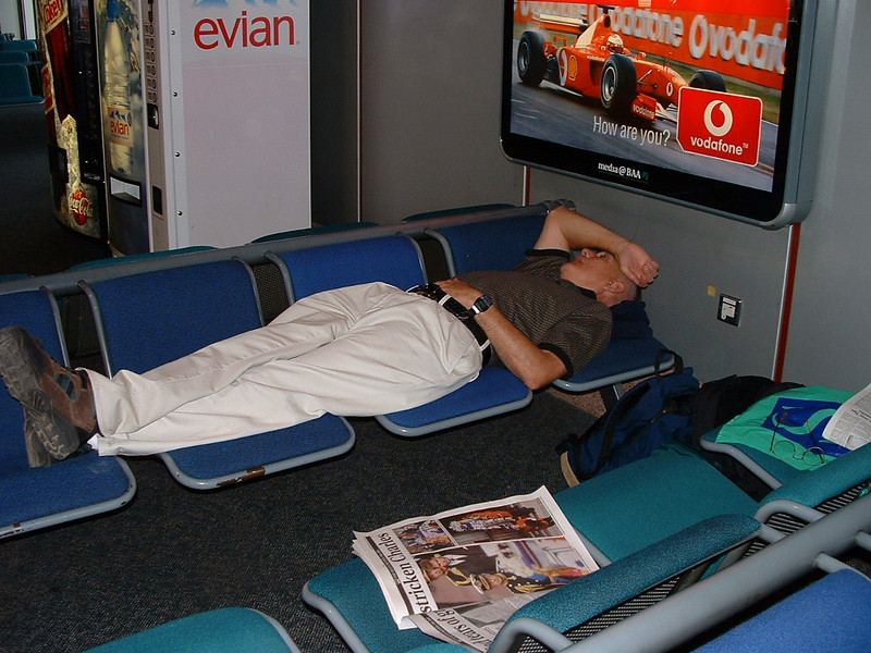 Chuck taking a nap in the airport while waiting for our connecting flight to Johannesburg, South Africa