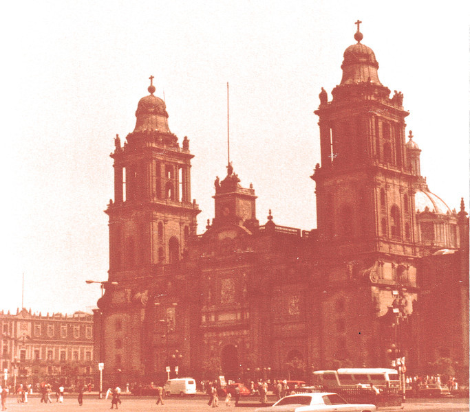 Cathedral on Zocalo - Mexico City - May 1979<br /> Once the main center of the Aztec capital Tenochtitlan, this is the beating heart of Mexico's capital. Within a few meters you will discover pre-Hispanic ruins and majestic colonial buildings. In the surrounding streets you will encounter a cross section of Mexico City's population: business executives, workers, and fashionistas, as well as vendors, buskers and Aztec dancers. Tourists and locals alike wander these streets where Mexico's past and present intersect.<br /> <br /> The main square of the city is called the Zocalo but its official name is Plaza de la Constitucion. It takes up a whole city block and is among the largest squares in the world where people gather for civic and cultural events and celebrations throughout the year. Over the years the Zocalo has undergone several different incarnations; inside the Zocalo metro station you can see scale models of its many different phases.