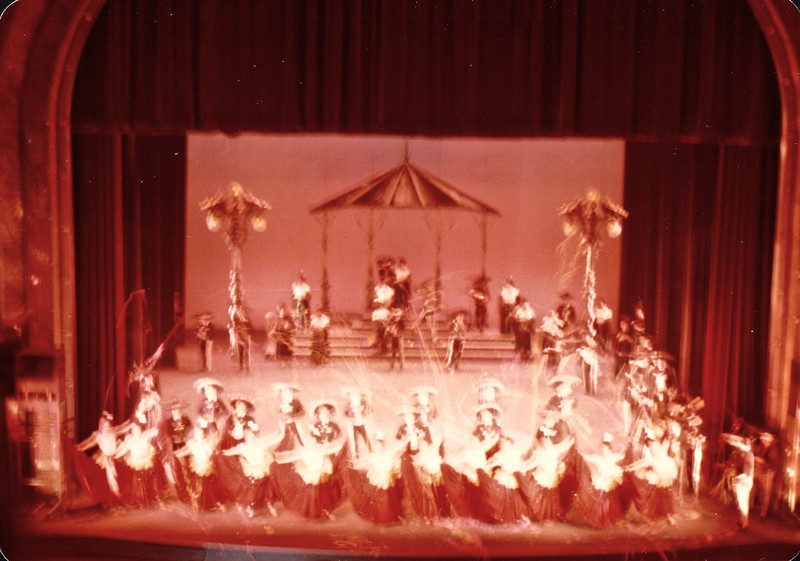 Ballet Folklorico - Mexico City - May 1979<br /> A woman with a warm smile on her face twirls her multicolored skirt round and round. Clicking his boots on the hardwood floor, a man in a three-piece suit dances circles around the senorita. This is a unique example of ballet folklórico, a broadly used term to describe all forms of Mexican folk dancing.
