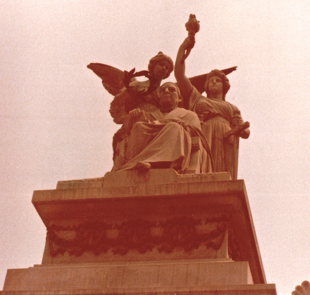 Benito Juarez Monument - Mexico City - May 1979<br /> Top of the monument has Juarez seated, an angel and a woman holding a torch.  Hundreds of other monuments honor the much-loved mid-19th century President Benito Juarez, who led the country during a French-backed attempt to impose an Austrian archduke as Mexican emperor.