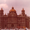 Basilica de Guadalupe - Mexico City - May 1979<br /> The Basílica occupies the site where, on December 9, 1531, a poor Indian named Juan Diego saw a vision of a beautiful lady in a blue mantle. The local bishop, Zumarraga, was reluctant to confirm that Juan Diego had indeed seen the Virgin Mary, so he asked the peasant for evidence. Juan Diego saw the vision a second time, on December 12, and when he asked her for proof, she instructed him to collect the roses that began blooming in the rocky soil at his feet. He gathered the flowers in his cloak and returned to the bishop. When he unfurled his cloak, the flowers dropped to the ground and the image of the Virgin was miraculously emblazoned on the rough-hewn cloth. The bishop immediately ordered the building of a church on the spot, and upon its completion, the cloth with the Virgin's image was hung in a place of honor, framed in gold.