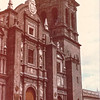 """Cathedral of the Immaculate Conception - Puebla, Mexico - May 1979<br /> Legend has it that once the building of Our Lady of the Immaculate Conception Cathedral came to a close, right on the heart of the city of Puebla, the question of how to raise an 18,000 pound bell to the top of its towers (the highest ones in Latin America) came about. This question caused sleepless nights for the engineers and construction workers. It looked like an impossible task. However, one morning, the city of Puebla awoke to the news that the bell was already atop of the tower, pealing with joy. """"But who took it up there and how?"""" everyone was asking. And since it looked like a miracle, no one doubted that angels probably had come down to raise the bell to what is its resting spot since then. This legend is the reason this beautiful city is known as Puebla de los Angeles."""