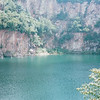 Beautiful Lake in What Used to Be a Quarry - Hindhede Nature Park, Part of Bukit Timah Nature Reserve - Singapore - March 2002<br /> Composed mainly of granite, Bukit Timah Hill was once an active quarrying site in the mid-1900s. One abandoned quarry has been developed as a park.