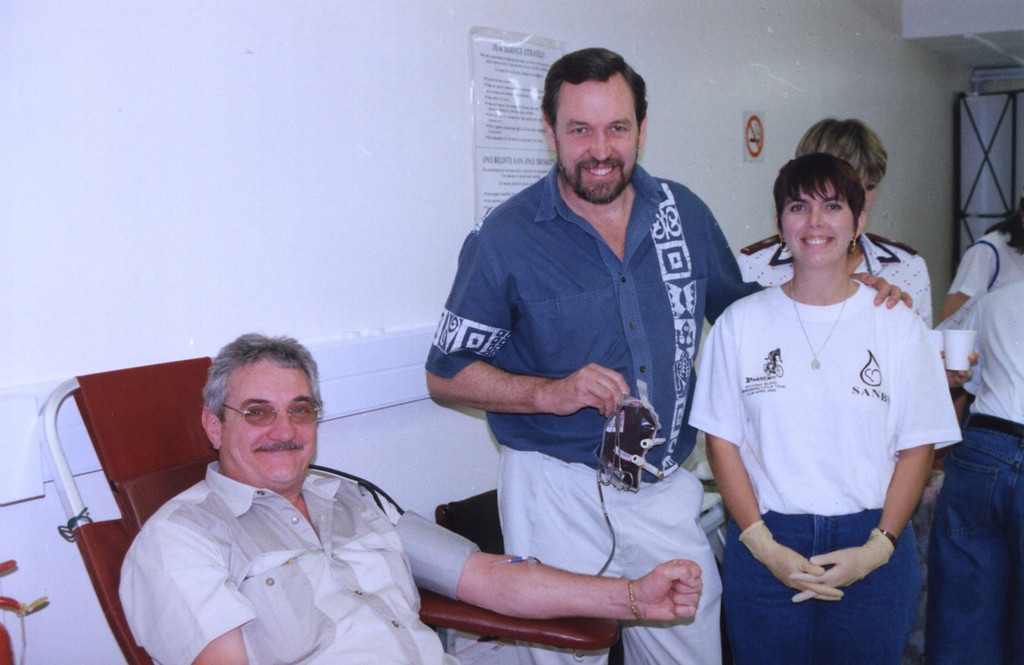 Dr. Crooks standing beside Ciril Di Coning (Diane's husband)  giving blood after the ride was over.