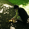Donna Enjoying Cat in Botanical Garden, Visby Sweden