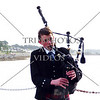 A young man plays the bagpipe for arriving cruise passengers at the port terminal in Invergordon, Scotland.