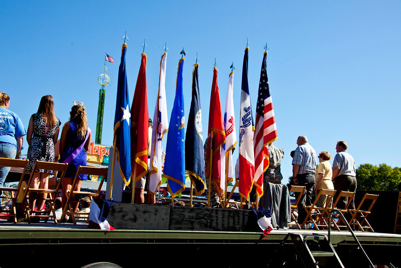 Back of the reviewing stand, as the parade passes in front. ISF Queen (with sash) on left, Governor (in plaid) on right.
