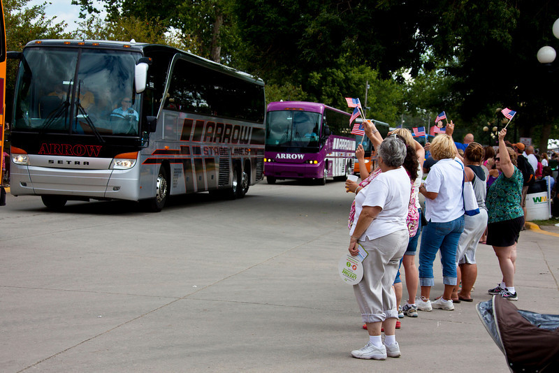 The buses were greeted by a blocks-long throng of flag wavers.