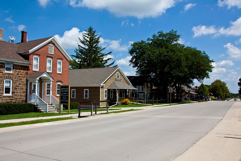 Main Street in Amana, IA. Amana is one of the seven Amana Colonies, founded in 1855 by Pietist/Mystic Gereman refugees on 26,000 acres in Eastern Iowa. Today, the Amana appliance factory provides most of the jobs, along with argiculture, and numerous fabulous restaurants.