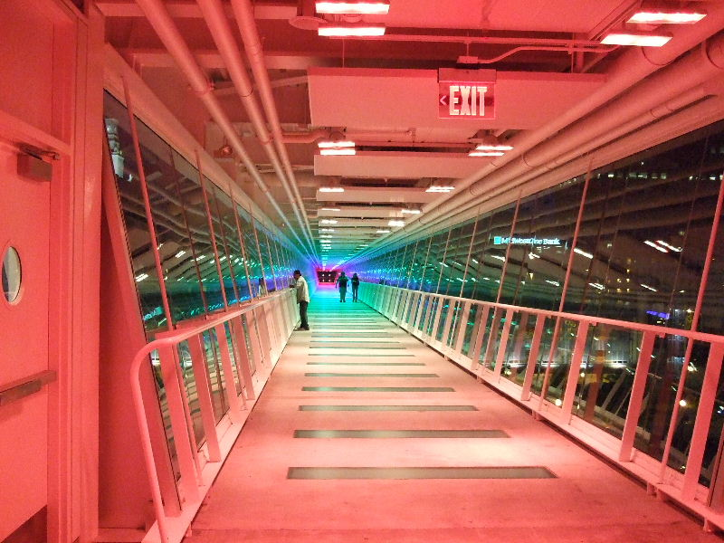 Different colored lights race from end to end of the Davenport Skywalk