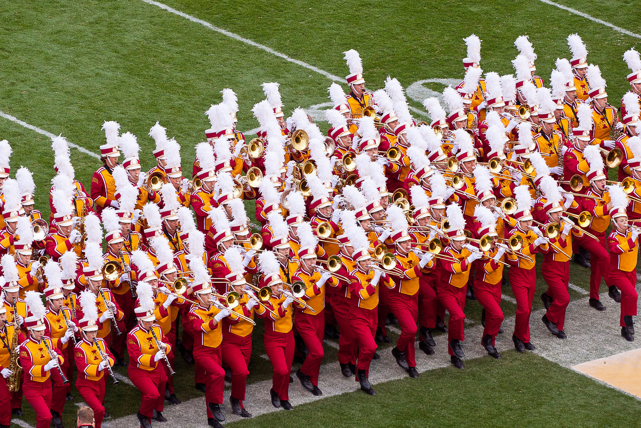 The band compresses on the sideline as they march off after the halftime show.