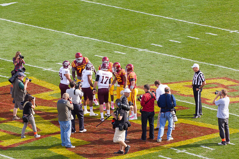 The Aggies and Cyclones toss the coin and shake hands prior to the start of the game.